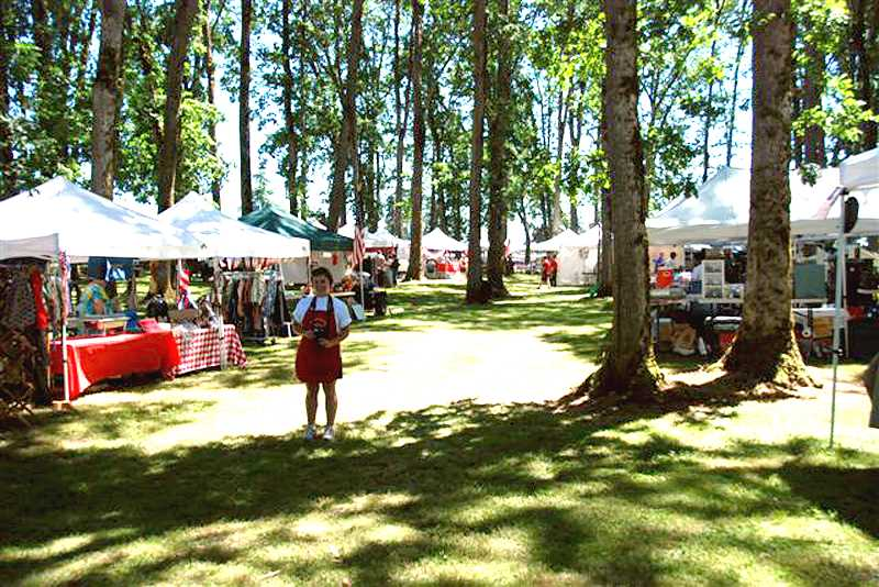 by: WILDRIVER BBQ - The barbecue event is held in a shady Oak Grove near the rodeo grounds in Molalla.