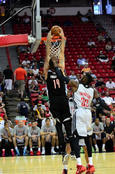 by: COURTESY OF MIKALAN MOISO - Joel Freeland of the Trail Blazers goes to the rim during one of Portland's games at the 2014 Las Vegas Summer League, which has developed into a week-long extravaganza.