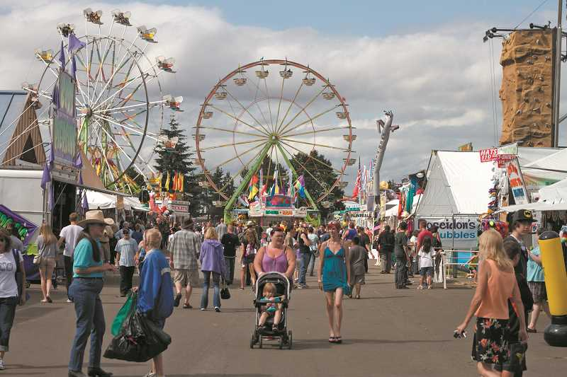 by: NEWS-TIMES FILE PHOTO - Without 4-H programs, the Washington County Fair would just be another carnival, according to Pat Willis of the Oregon State University Extension Service.