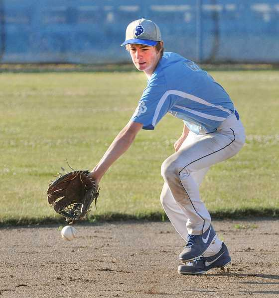 by: SETH GORDON - Making a stop - Zach Tegland backhands a ground ball during St. Paul's 6-2 home loss to Gaston Monday. The Bucks hung tight with the more experienced Greyhounds before a three-run home run in the top of the fifth inning propelled the visitors to victory.