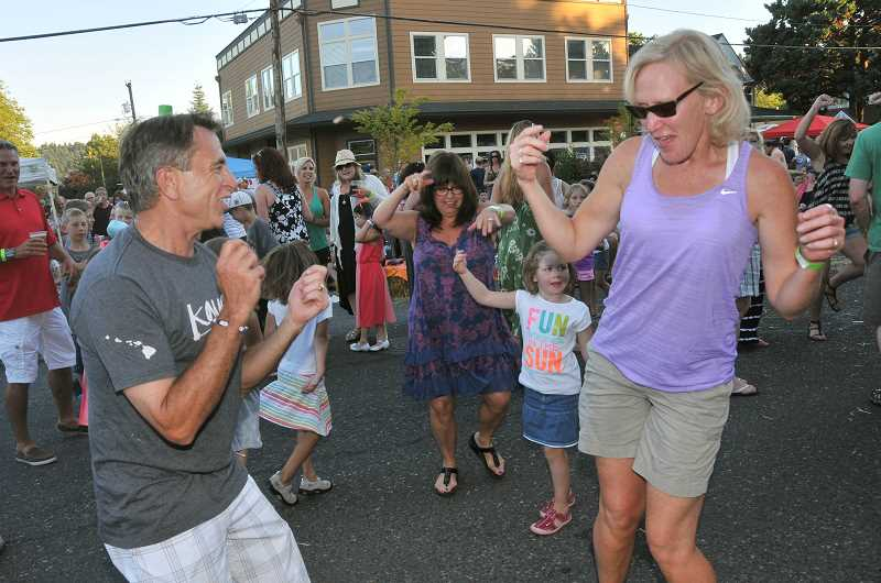 by: STAFF PHOTOS: VERN UYETAKE - David Renton and Amy Gertenrich have a fun time dancing to the music of Big Night Out.