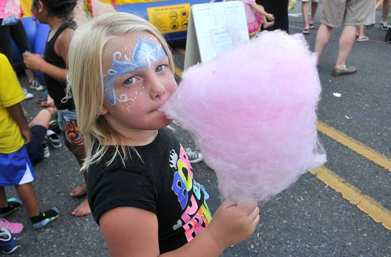 Ruby Sprague, 4, of West Linn enjoys her cotton candy.