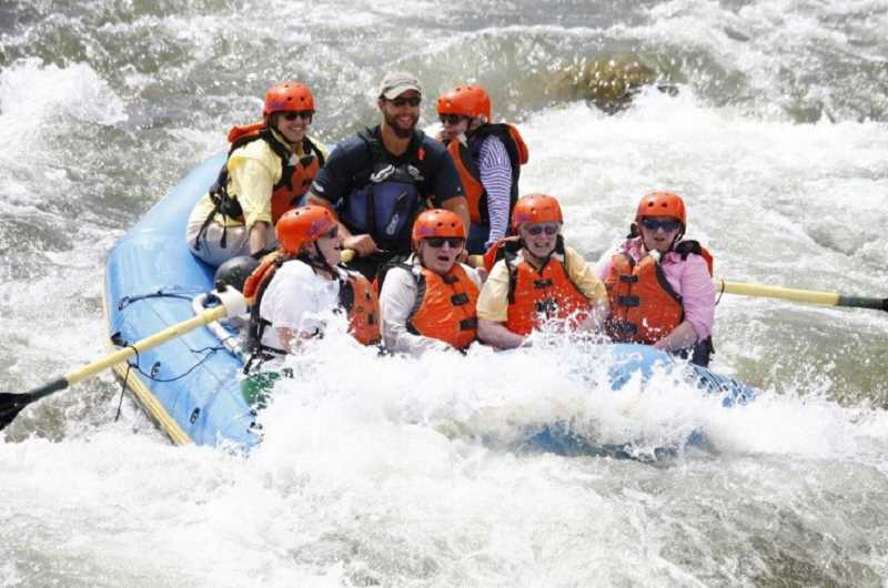 by: SUBMITTED PHOTO - Rhenda Wilson took a group of seniors whitewater rafting, at their insistence. They were thrilled with the adventure. She is pictured in the back of the raft, along with the nonagenarian she was responsible for keeping in the raft.