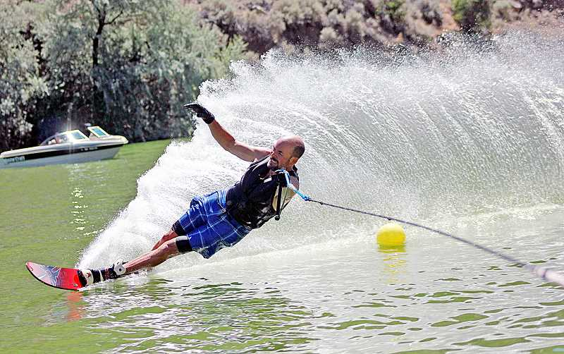by: PIONEER FILE  PHOTO - Blaine Florence cuts a turn during last year's Sundance Water Sports tournament on Lake Billy Chinook.