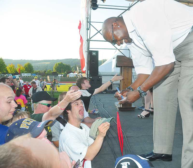 by: GARY ALLEN - Portland Trail Blazer great Jerome Kersey signed autographs and spent time with athletes during the opening ceremony Saturday on Loran Douglas Field at Newberg High School.