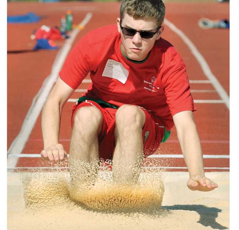 by: GARY ALLEN - An athlete comes in for a landing in the long jump pit Saturday morning.