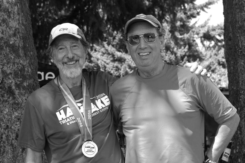 by: NEWS-TIMES PHOTO: DAVID ROZA - Forest Grove residents Steve Whisler (left) and Christopher Toole relax in the shade after finishing the Hagg Lake Triathlon on Saturday.