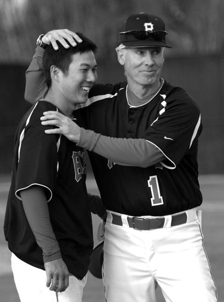 Pacific baseball coach Greg Bradley (right) congratulates a player after a game on March 28, 2008. Bradley officially retired this year.