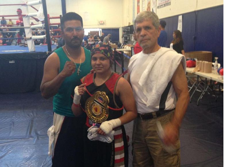 by: COURTESY PHOTO: JOCELYN SIMPSON - 16-year-old Angie Ornelas won the National Adidas Police Activities League Boxing Tournament in Oxnard, Calif., in June, overcoming an injury to her left arm for the title belt.