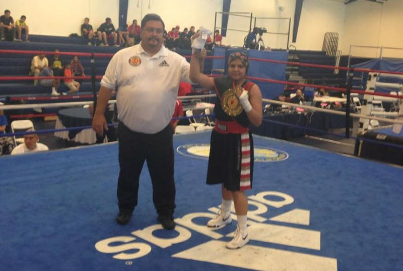 by: COURTESY PHOTO: JOCELYN SIMPSON - Angie Ornelas won the National Adidas Police Activities League Boxing Tournament so quickly, the boxer was still taking off her gloves when she was named champ.