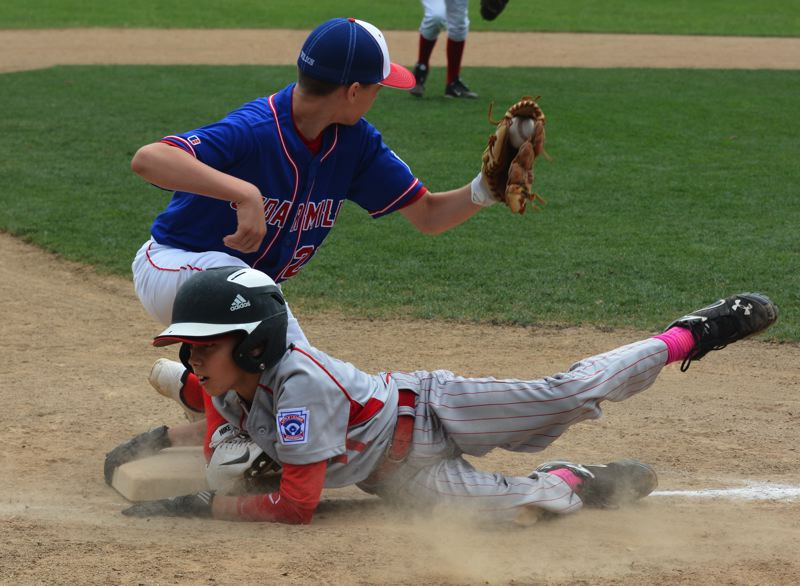 by: TIMES PHOTO: MATT SINGLEDECKER - Raleigh HIlls catcher Curtis Posner dives back into third base in the District Four Championship Game on Sunday.