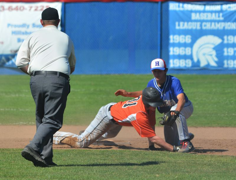 by: TIMES PHOTO: MATT SINGLEDECKER - Beavertons Tovey Brown tries to avoid a Hillsboro tag after a basehit in the third inning of the Beavers 6-2 OIBA win on Monday.