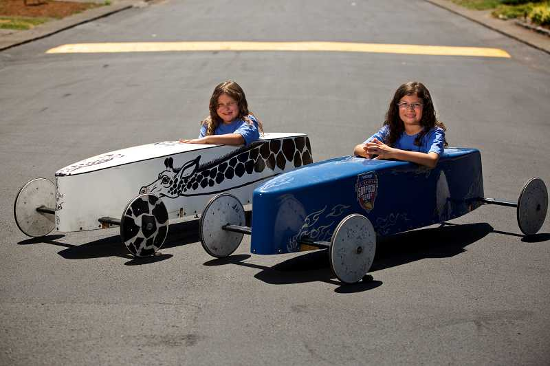 by: TIMES PHOTO: JAIME VALDEZ - Aleiah Barnes, 8, and her sister, Ileiza, 11, are soap box derby racers from King City with a passion for their sport. The girls race a few times a month all over the state.