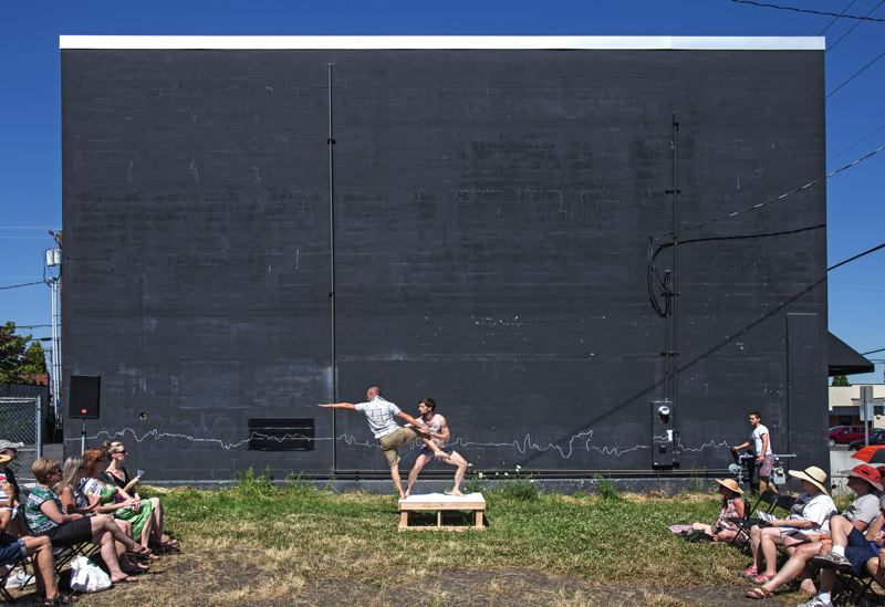 by: TIMES PHOTO: JONATHAN HOUSE - Luke Gutgsell and Eric Nordstrom perform in a vacant lot during the Ten Tiny Dances event in downtown Beaverton.