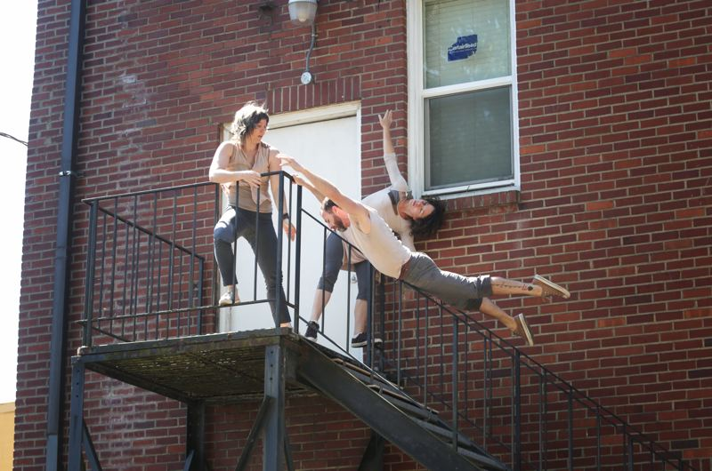 by: TIMES PHOTO: JONATHAN HOUSE - The POV Dance troupe, consisting of Mandy Cregan, Noel Plemmons and Rachael Lembo, abandoned the stage in favor of a stairwell to perform their untitled piece.