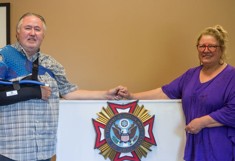 by: TIMES PHOTO: JONATHAN HOUSE - Beaverton resident and military veteran Robert Gustafson stands with his wife Stephanie in the the Veterans of Foreign Wars Post 3452 building in Tualatin. Gustafson is the second Save Our Veterans patient to receive free surgery.
