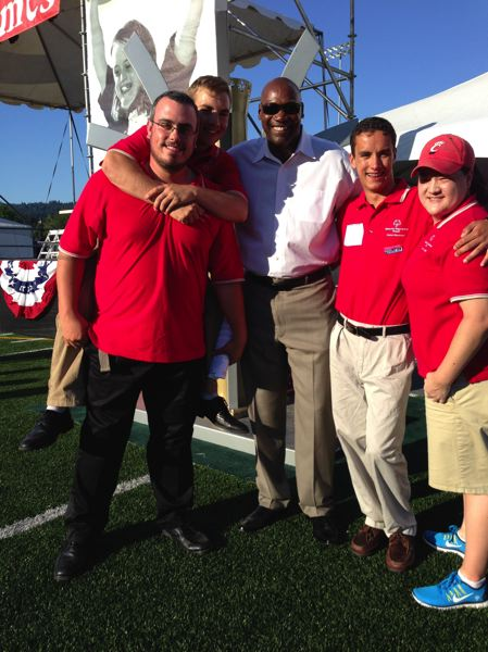 by: CONTRIBUTED PHOTO - Brandon Wynne shares a smile with Levi Arthur, Jerome Kersey, a former Portland Trailblazer, Travis Koski and Courtney Ngai, while participating as Global Messengers emcees from Washington County at the 2014 Special Olympics Oregon ceremonies.