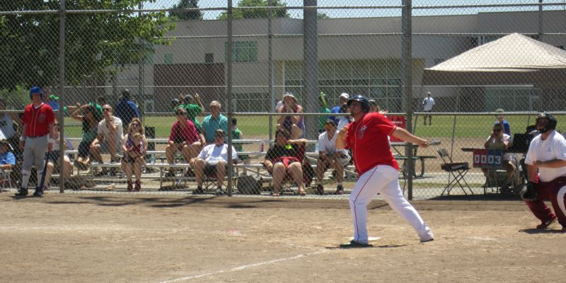 by: CONTRIBUTED PHOTO - Brandon Wynne knocks a hit during the 2014 Special Olympics Oregon games. Just like last year, Wynne's Washington Wildcats softball team took a first-place gold medal in the games on July 12 and 13.