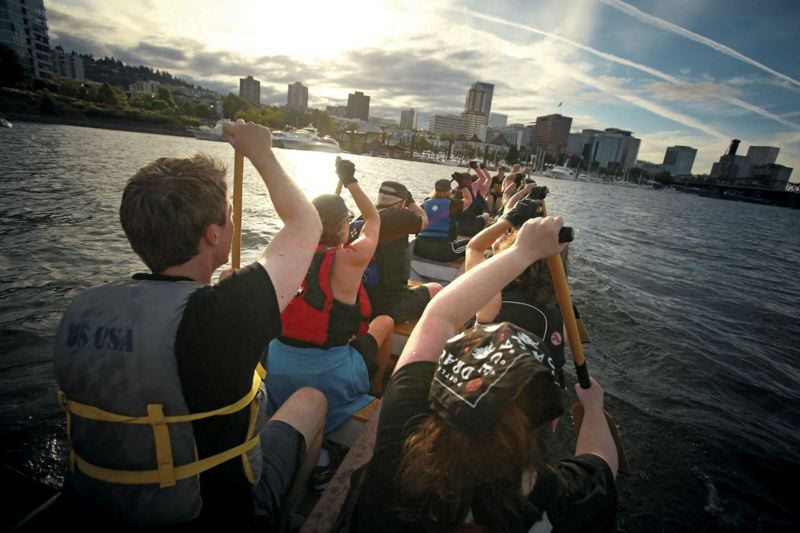 by: TRIBUNE PHOTO: JONATHAN HOUSE - The sun dips low as the Castaways returns to dock after practice on the Willamette River.