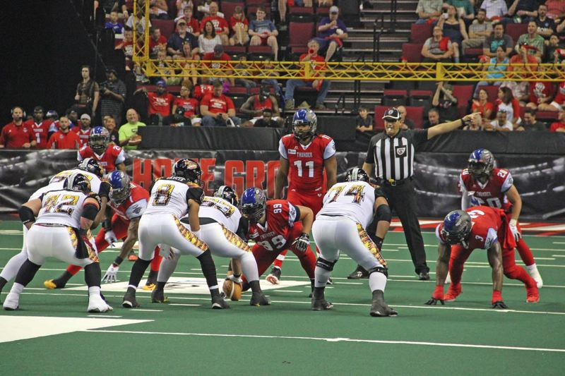 by: COURTESY OF BRIAN BEAUDRY - Linebacker Donte Paige-Moss (11) and the Portland Thunder defense line up to stop the Los Angeles KISS during last weeks game at Moda Center.