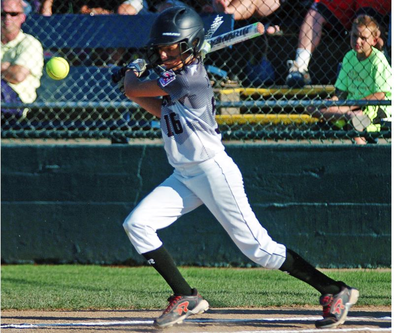 by: DAN BROOD - INTO PLAY -- Tigard/TC's Carly Atwood gets her bat on the ball during Monday''s tourney game.