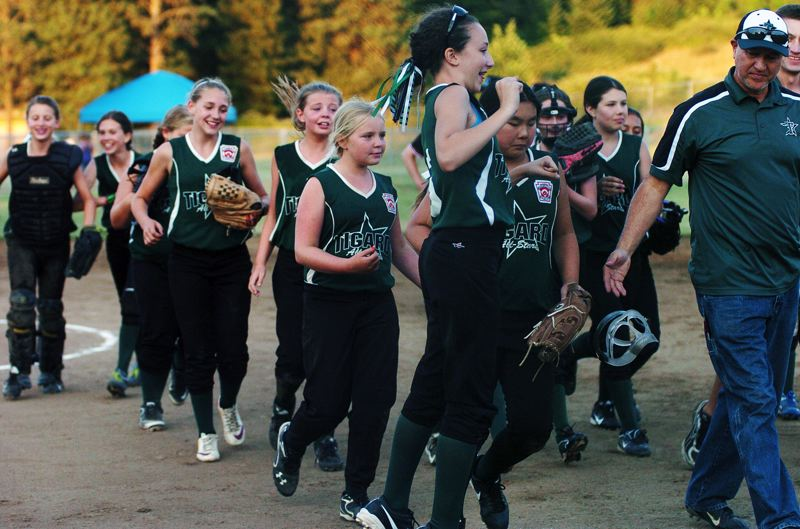by: DAN BROOD - JUMPING FOR JOY -- The Tigard Little League ages 10-11 all-star softball team, with Kaitlyn Cafarelli in front, starts celebrating following the team's 11-8 win over Centennial in the Oregon State Tournament championship game, held Sunday in Salem.