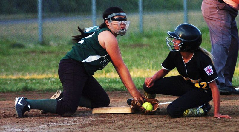 by: DAN BROOD - TAGGED OUT-- Tigard third baseman Kaylee Mo (left) puts a tag on Centennial's Keri Jensen on a stolen base attempt in Sunday's state championship game. Tigard got an 11-8 victory.