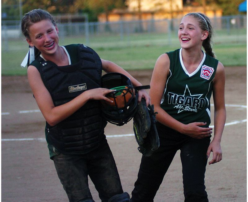by: DAN BROOD - Tigard's Grace Nelson (left) and Abby Soderquist share a laugh and a smile after the state title-game win.
