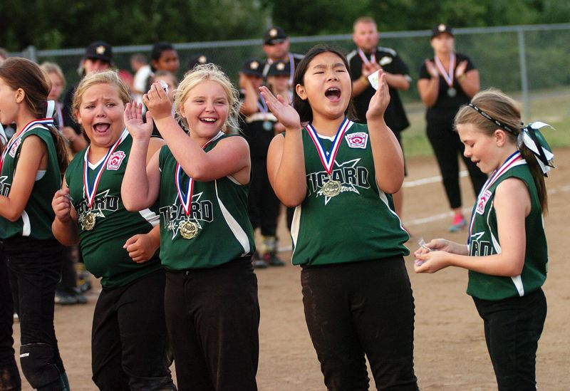 by: DAN BROOD - Tigard players let out a yet during the medal presentations.