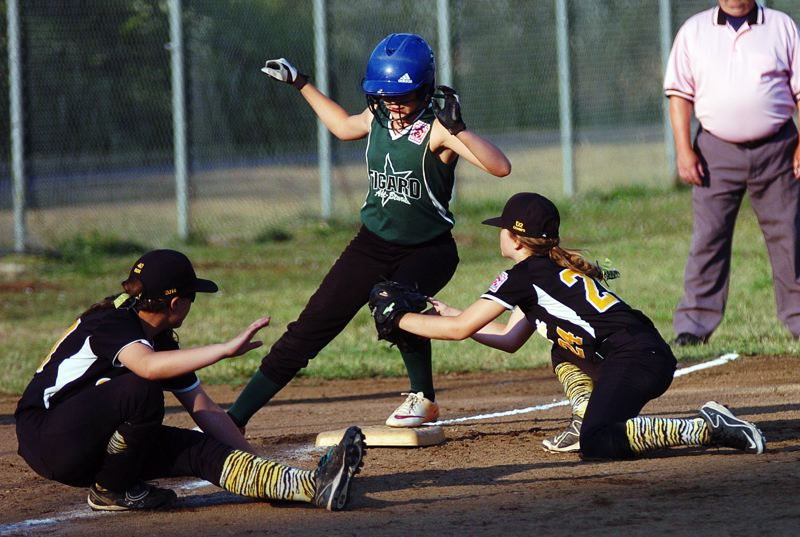 by: DAN BROOD - Tigard's Abby Soderquist, between Centennial's Kendall Hemmer (left) and Trinithy Miller, is safe at third base.