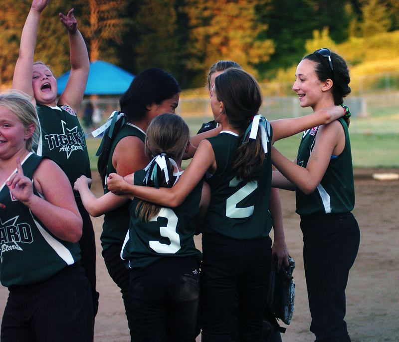 by: DAN BROOD - Tigard players celebrate after their state title game victory.