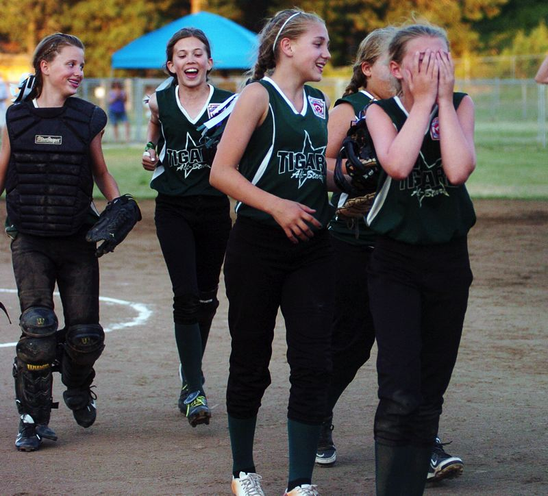 by: DAN BROOD - Tigard players (from left) Grace Nelson, Elli Dardis, Abby Soderquist, Victoria Vanderburg and Alexa VanderSommen react following their state championship.