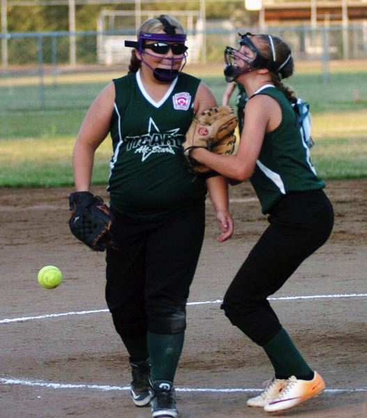 by: DAN BROOD - Tigard's Abby Soderquist (right) congratulates Victoria Vanderburg after she got an inning-ending strikeout in the bottom of the fifth.