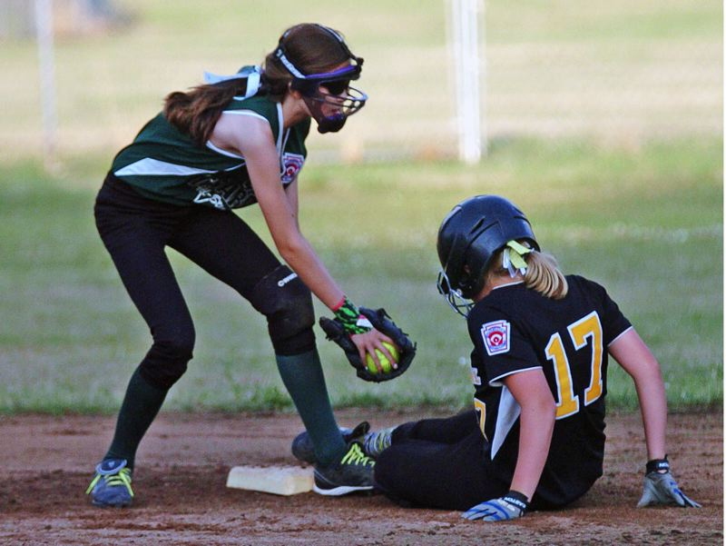 by: DAN BROOD - Tigard shortstop Elli Dardis (left) looks to put a tag on Centennial's Madison Northern.