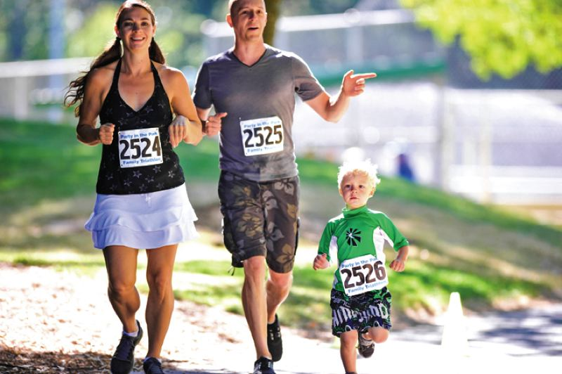by: TIMES PHOTO: JOHN LARIVIERE - Families are encouraged to complete a 50-yard swim, two-mile bike ride and a third-mile run together during the Family Triathlon on July 26 to kick off a day of fun at the Party in the Park.
