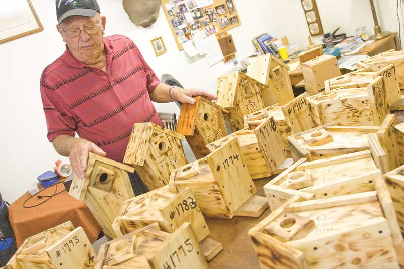 by: KEVIN SPERL - Trevor Russell has built over 1,800 bluebird houses to date.