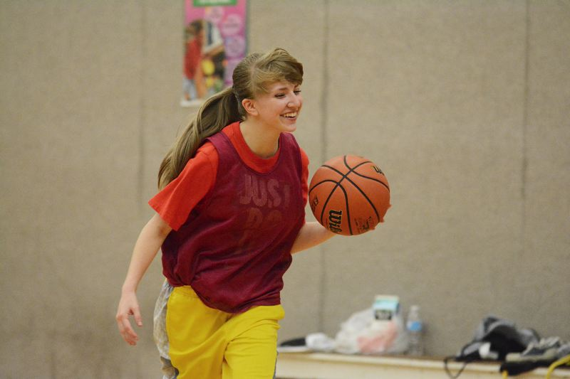 by: JOHN WILLIAM HOWARD - CJ Rehkoph shares a laugh during summer league practice on Wednesday, July 16. Rehkoph has been part of a younger group that head coach Billy McKinney says shows promise.