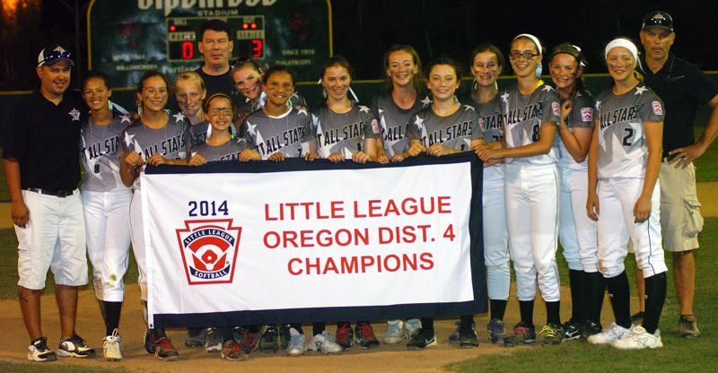 by: DAN BROOD - THE CHAMPS -- Tigard/Tualatin City players and coaches pose with the championship banner following their district tourney title win over Willow Creek.