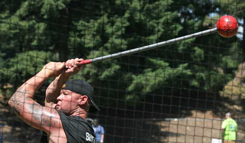 by: OUTLOOK PHOTO: JIM CLARK - Cory Brizendine throws the heavy Scottish hammer  during Portland Highland Games competition on Saturday at Mt. Hood Community College.