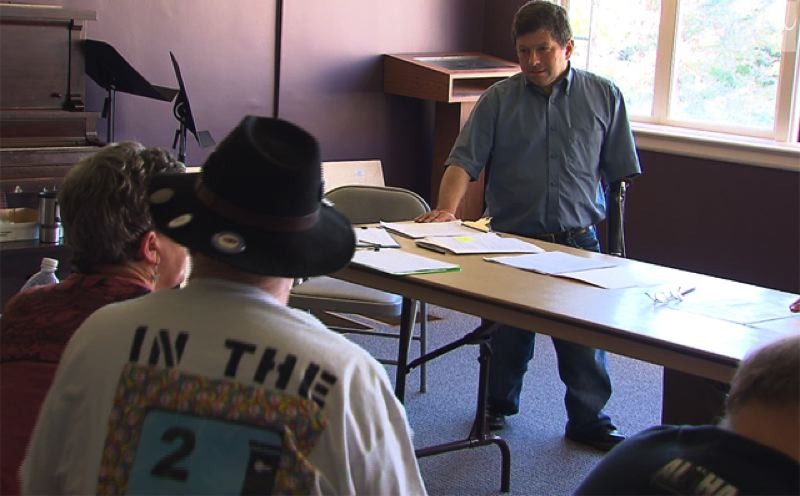 by: KOIN 6 NEWS - Steve Novick defends his position on the Portland Street Fee at a Charlie Hales-Steve Novick recall petition campaign planning meeting in Southeast Portland's Tabor Space on July 19.