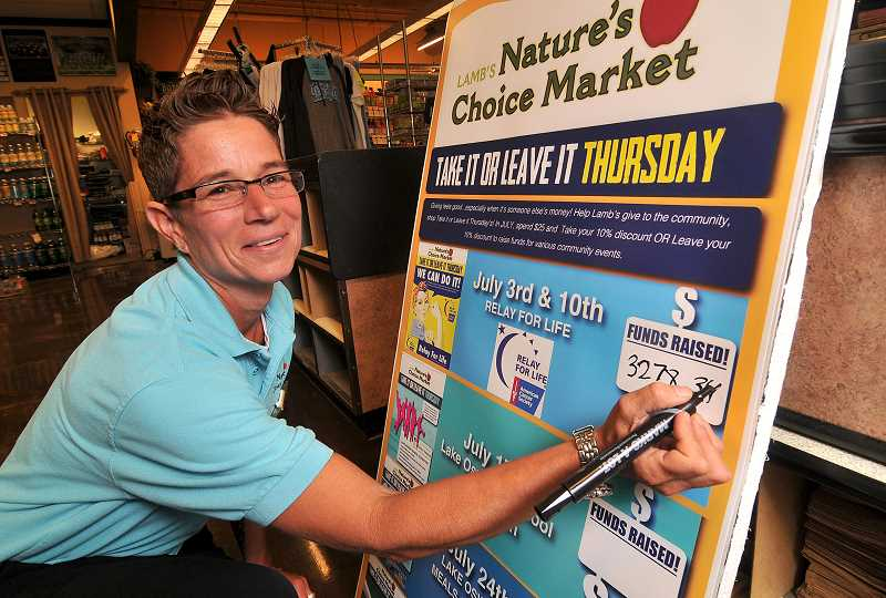 by: STAFF PHOTO: VERN UYETAKE - Lambs Natures Choice Market Grocery Manager Jackie Lagrande has launched the Take It or Leave It program for area nonprofit groups.