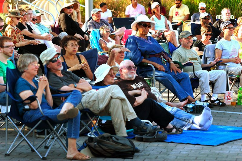 by: FILE PHOTO - Folks take in music on a sunny day at last years Mt. Hood Jazz Festival. The festival is open to folks of all ages and takes place at the Center for the Arts Plaza in downtown Gresham.