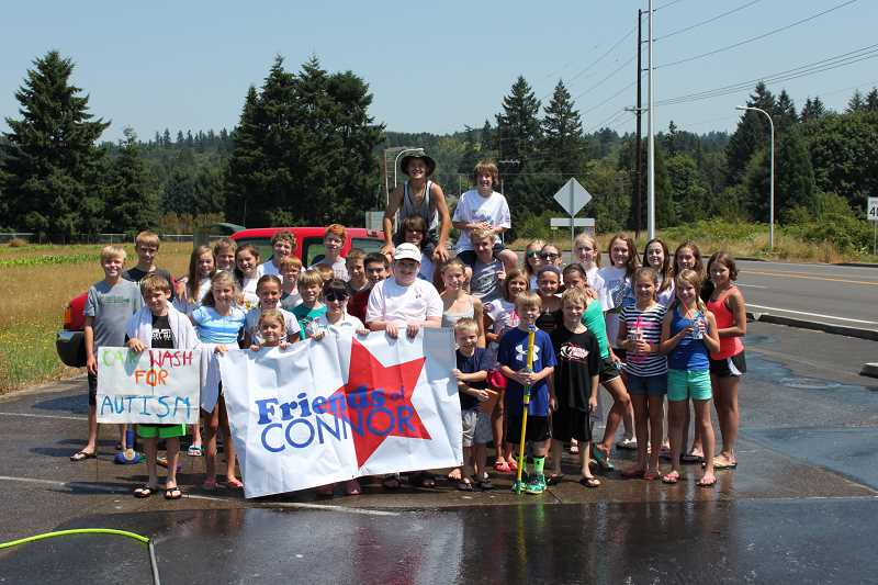 by: SUBMITTED PHOTO - The Friends of Connor raised money July 15 with a carwash held at Wanker's Corner. The students are all friends of Connor Tiffany and worked to support his family's nonprofit organization, the Tiffany Autism Foundation.