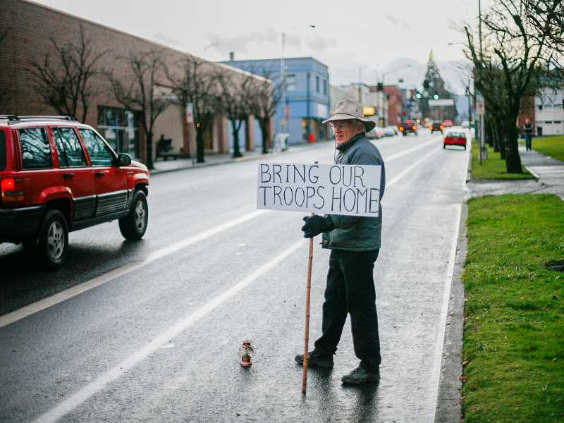 by: NEWS-TIMES FILE PHOTO - Before he had heart surgery early this month, Forest Grove resident Walt Wentz had missed only three Thursday evenings in 11 years of standing vigil on Pacific Avenue with his Bring Our Troops Home sign.