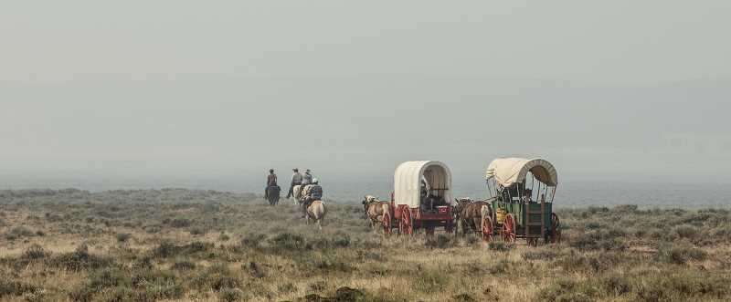 by: COURTESY PHOTO: MARK MCBREARTY - Riders on the 4-H Wagon Train headed into the haze last week as they trekked near Central Oregon wildfires.