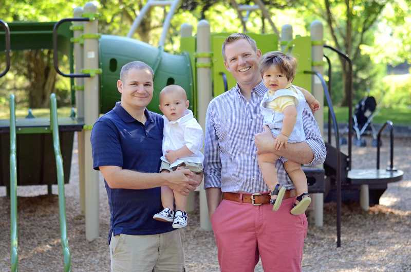 by: SUBMITTED PHOTO - The dynamic diapering duo of Paul Snowden (left, with son Carver) and Chad Carver (with son Wyatt) want to help new dads avoid trauma and sleep well at night.