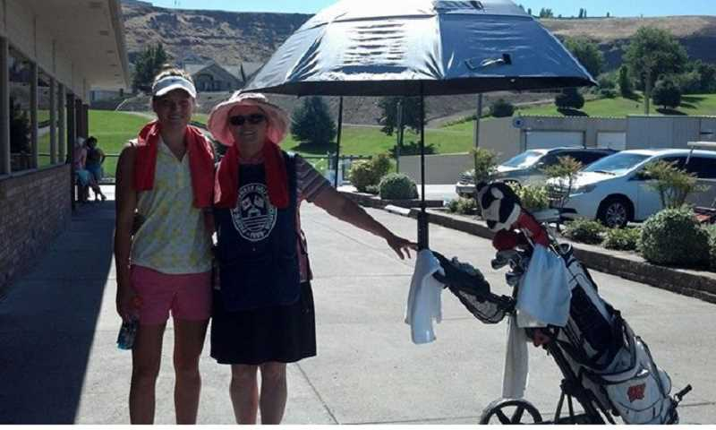 by: SUBMITTED PHOTO - Aaren Ziegler posing with her caddy during the Pacific Northwest Women's Amateur.
