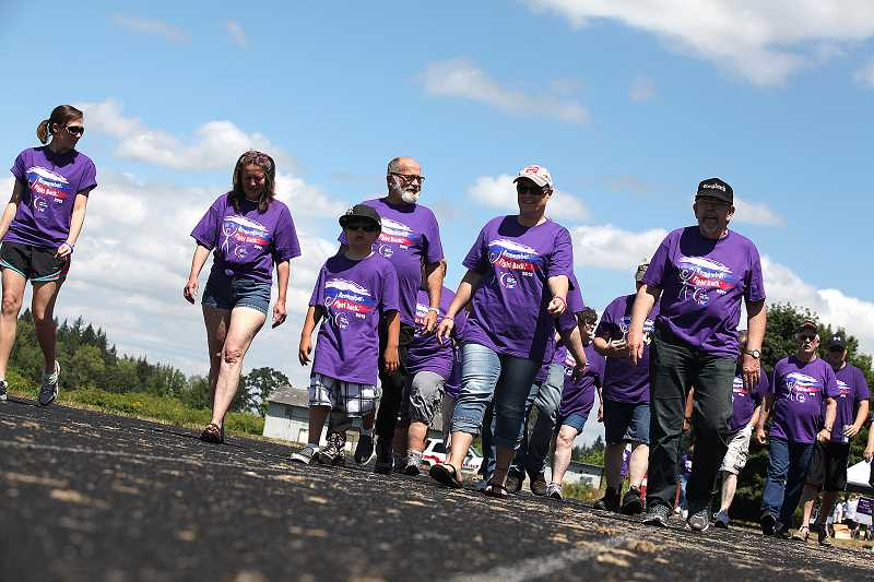by: CONTRIBUTED PHOTO - Young cancer survivor Mikey Miltenberger, center, walks in a past Relay for Life event. Mikey's mother, Brande, is the event chairwoman for the 2014 Estacada Relay for Life.