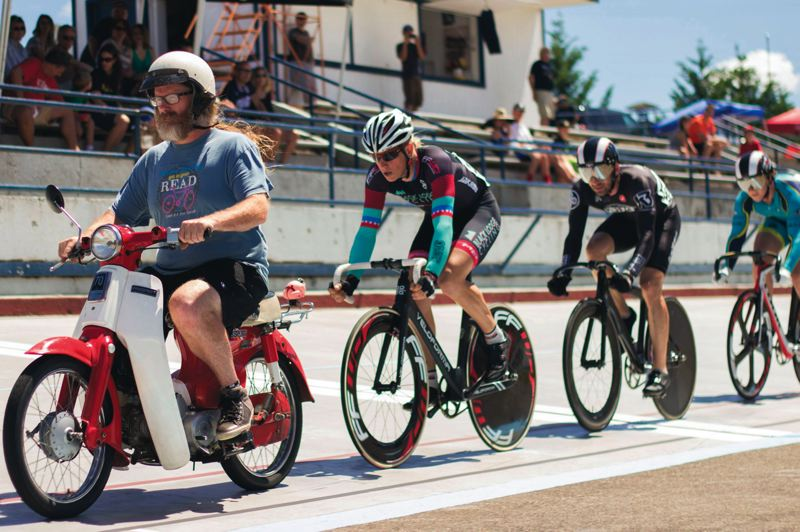 by: TIMES PHOTO: LACEY JACOBY - Powered by motor, Dean Reed leads the racers on a parade lap during the three-day event