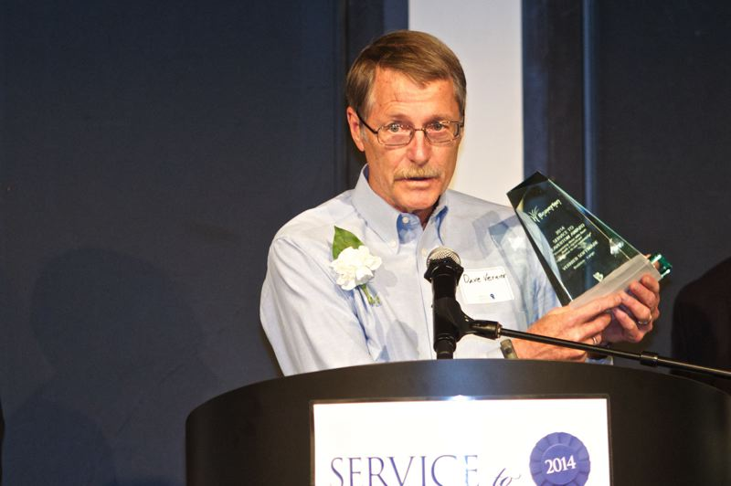 by: TIMES PHOTOS: JAIME VALDEZ - Vernier Software Founder Dave Vernier acknowledges winning the Large Business Award during Friday's Service to Beaverton luncheon.